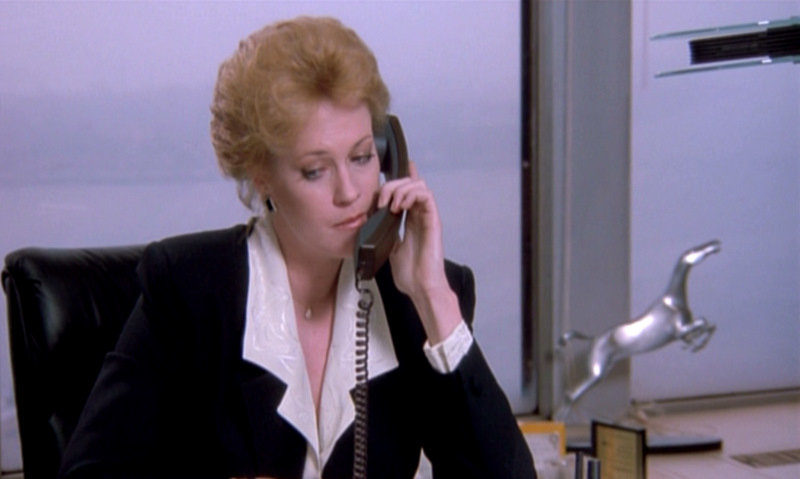 Working-Girl Melanie-Griffith Black-suit-hair-up-mid